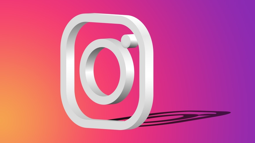 three-dimensional Instagram logo on a background that transitions from orange in the lower left corner to pink in the middle to purple on the right